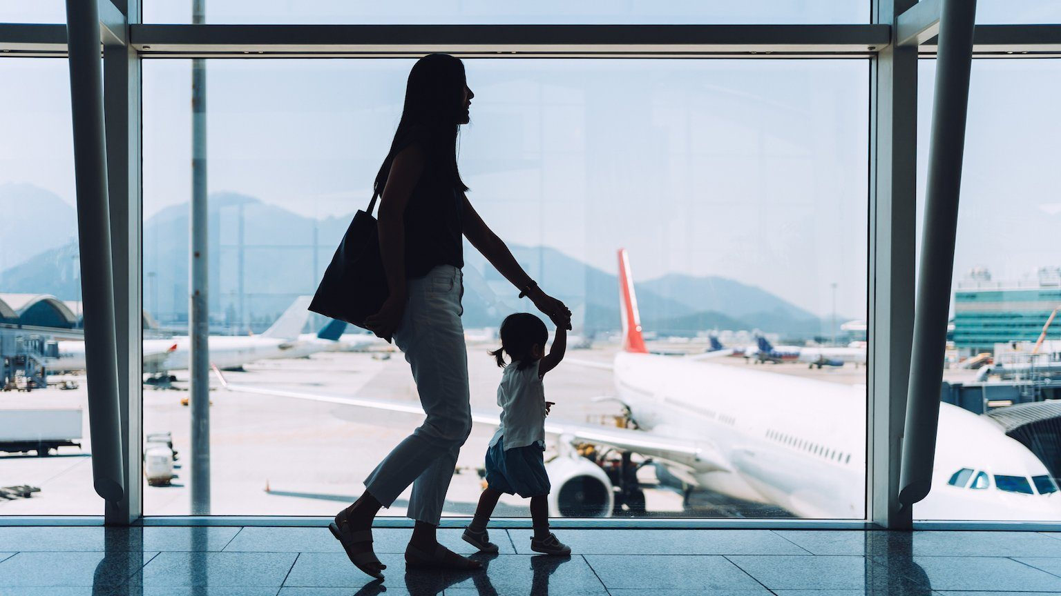 Lady and daughter at airport.
