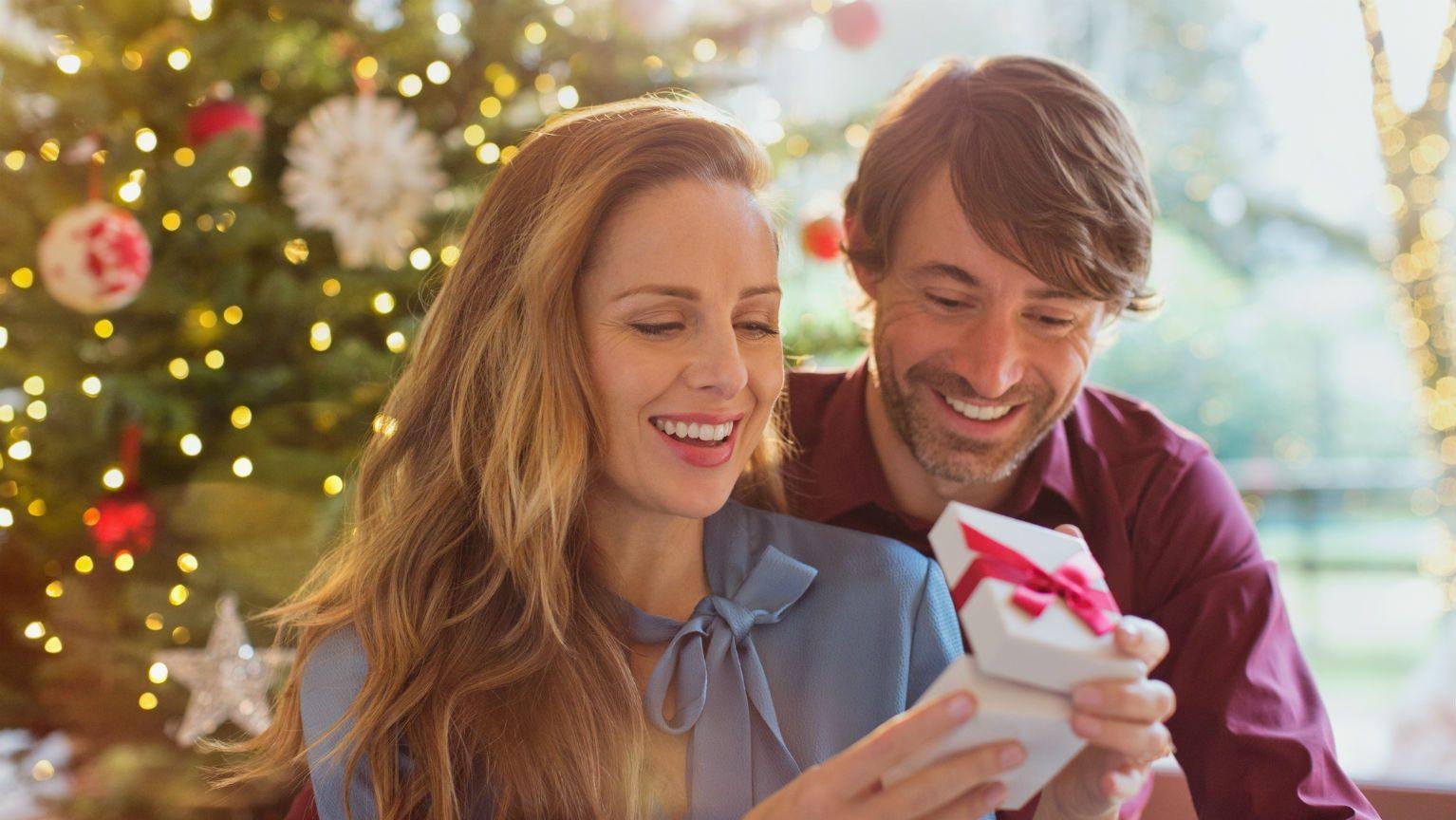Husband giving wife Christmas gift
