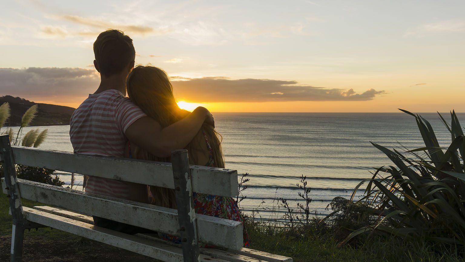 Happy couple enjoying the sunset.