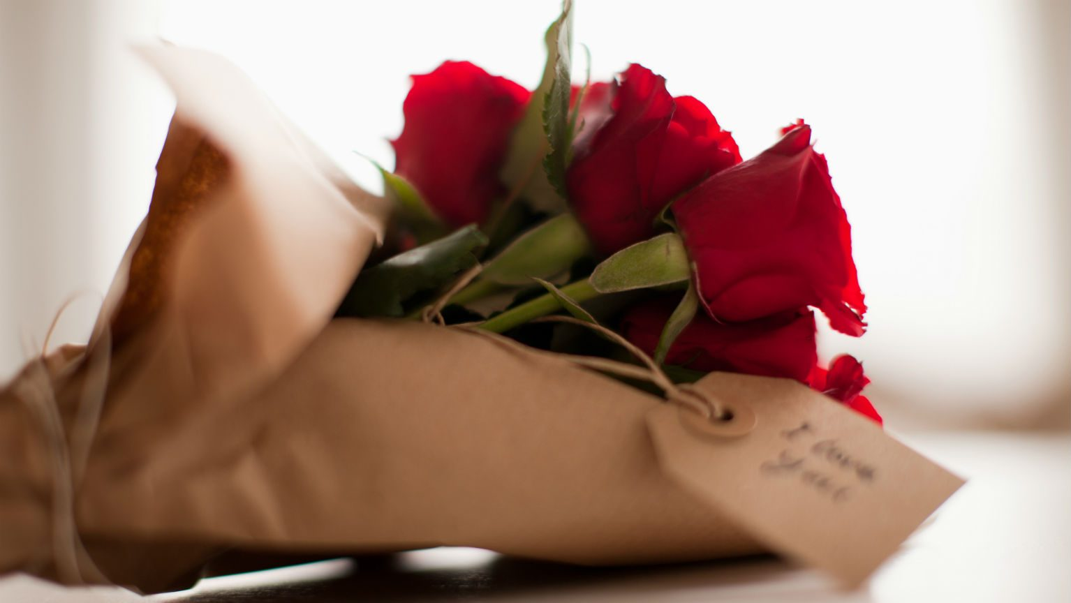 Red roses in brown paper