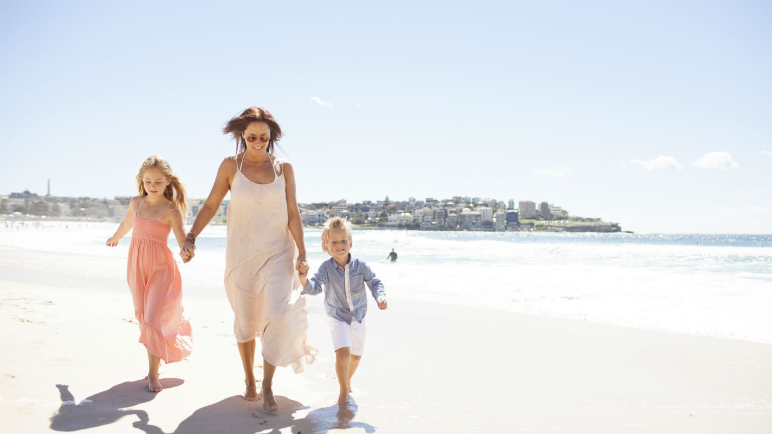Mother with children at the beach.