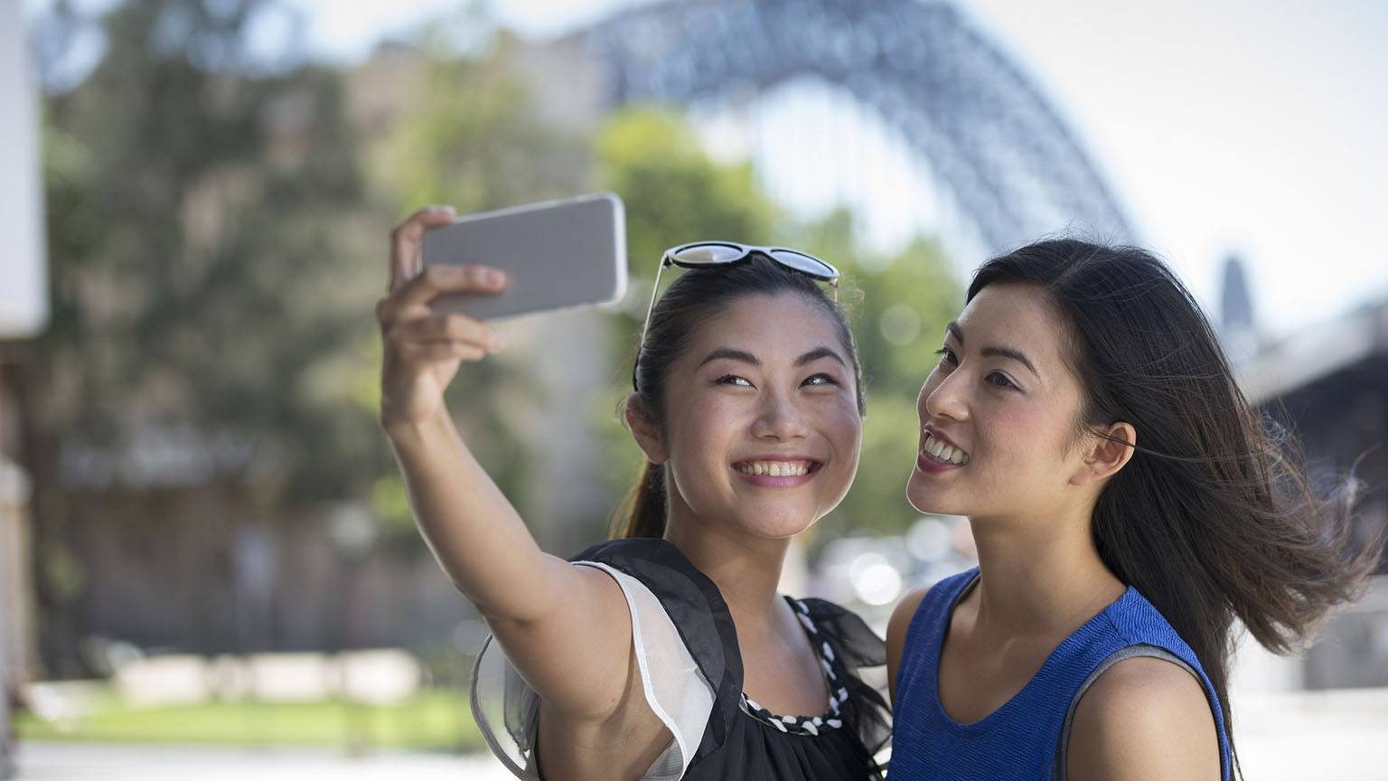 Two young asian woman