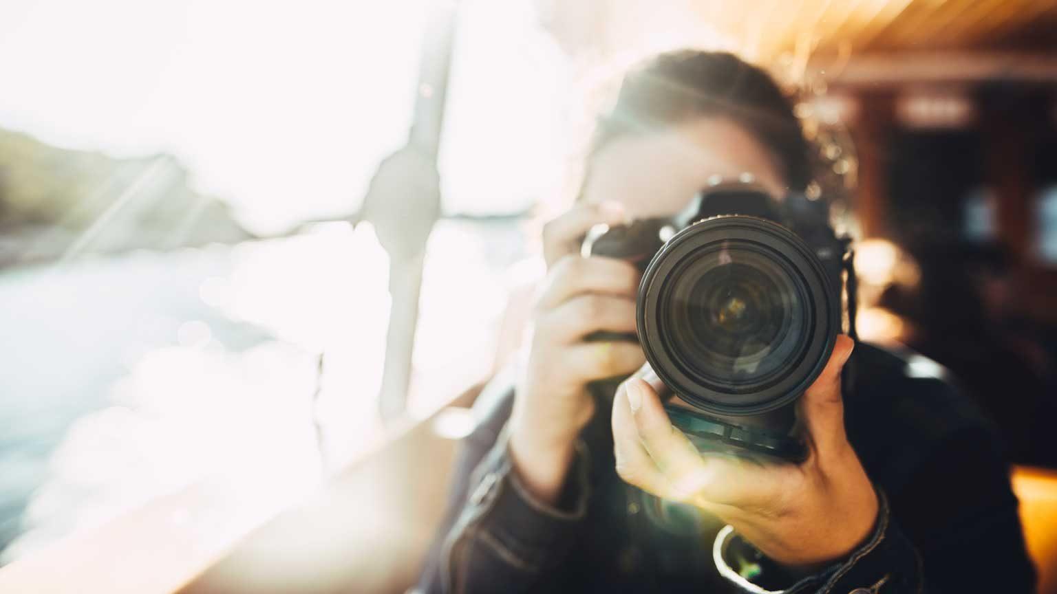 woman using a DSLR camera