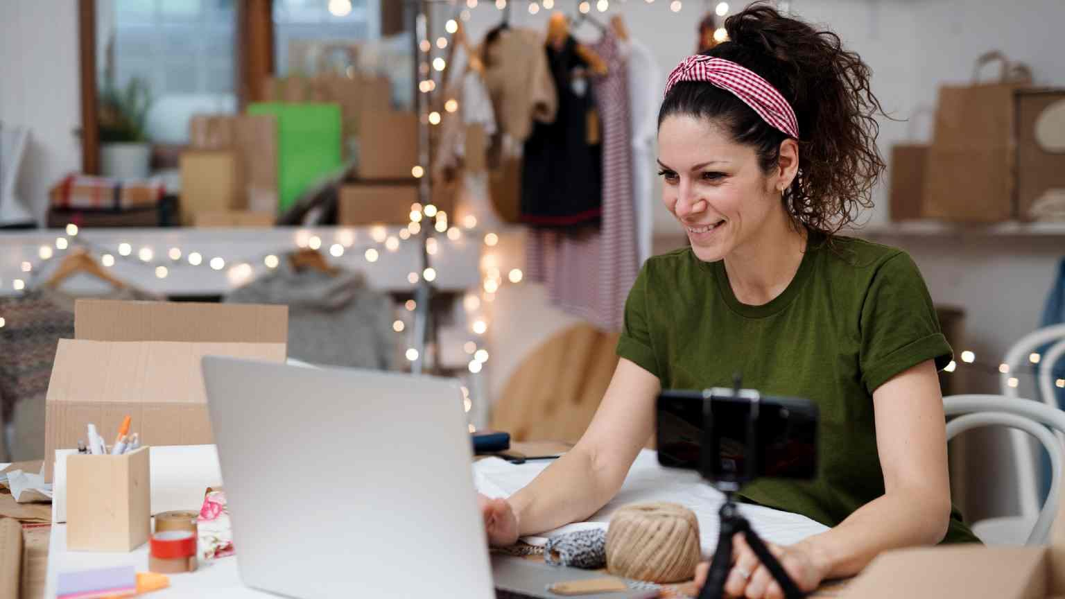 Woman holding and promoting handbag, new normal small business.