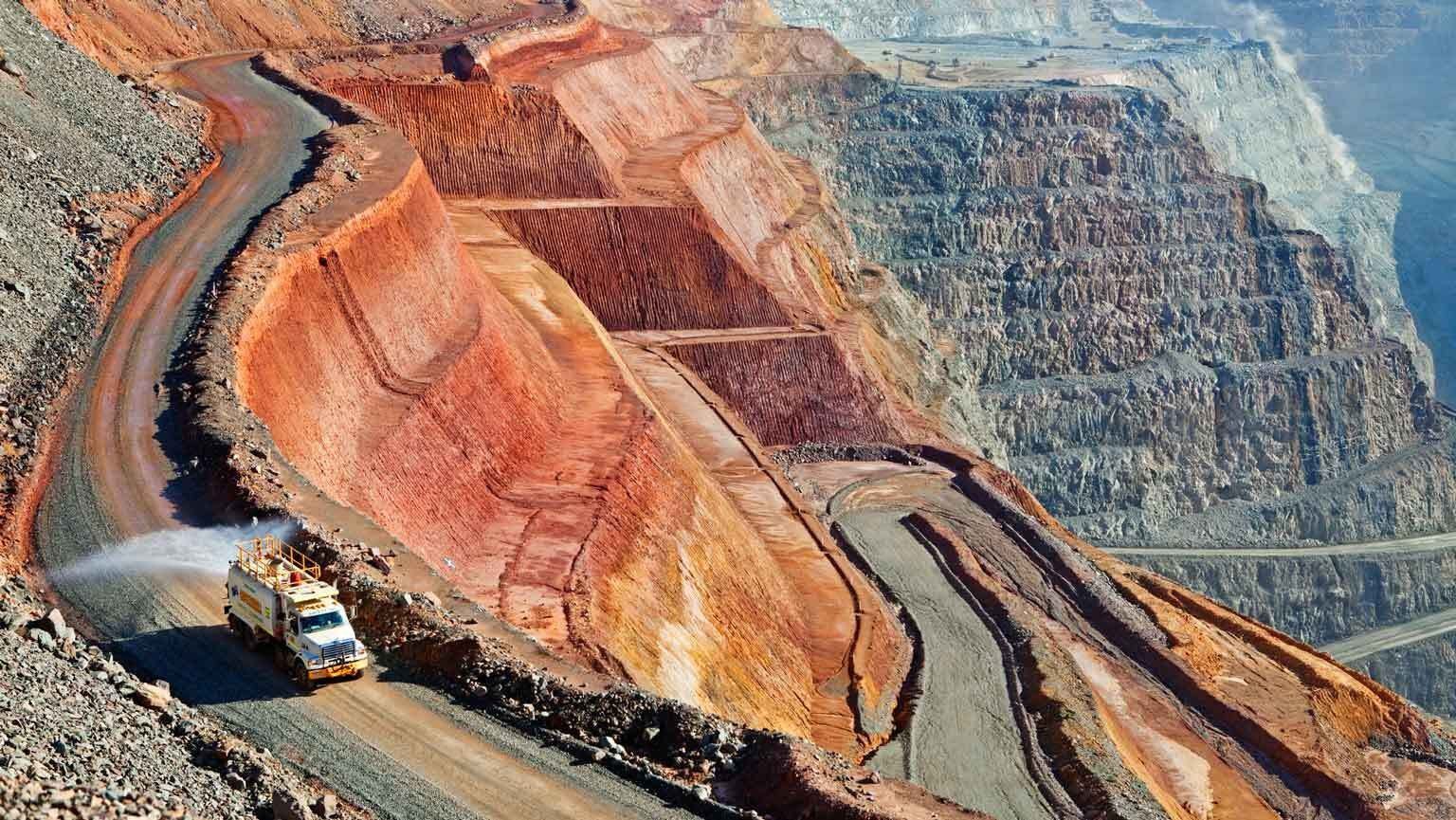 Water truck dampens road at KCGM mine (the Super Pit)