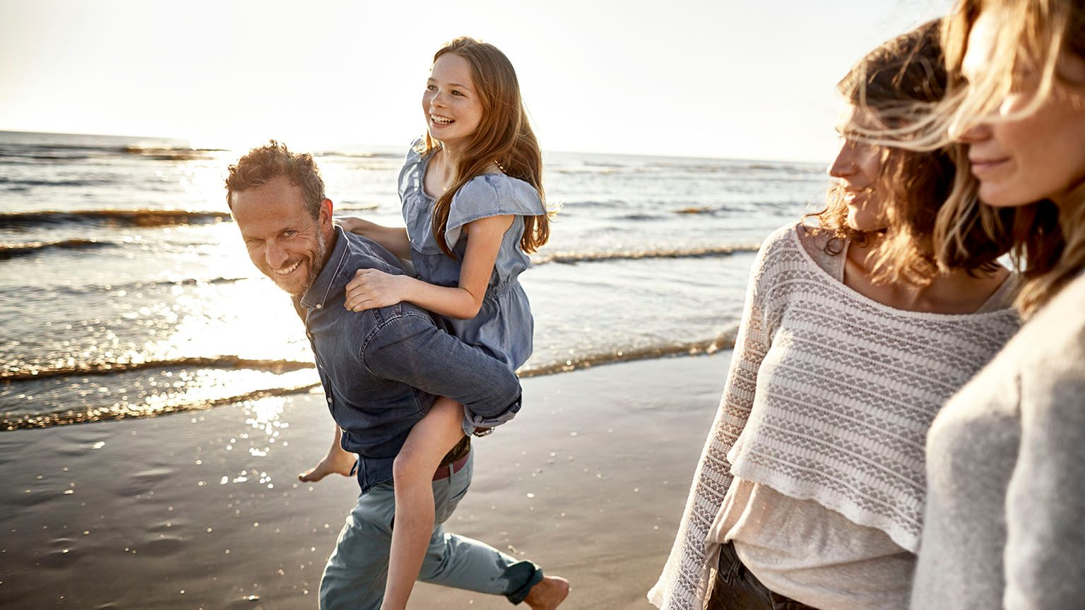 Family laughing on the beach.