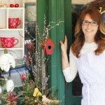 Small business owner outside her shop