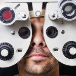 Man getting eyes calibrated by optometrist