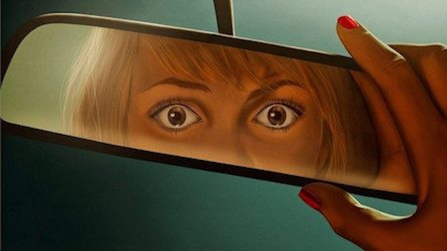 Woman looking at rearview mirror