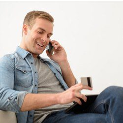 cheerful man talking on mobile phone
