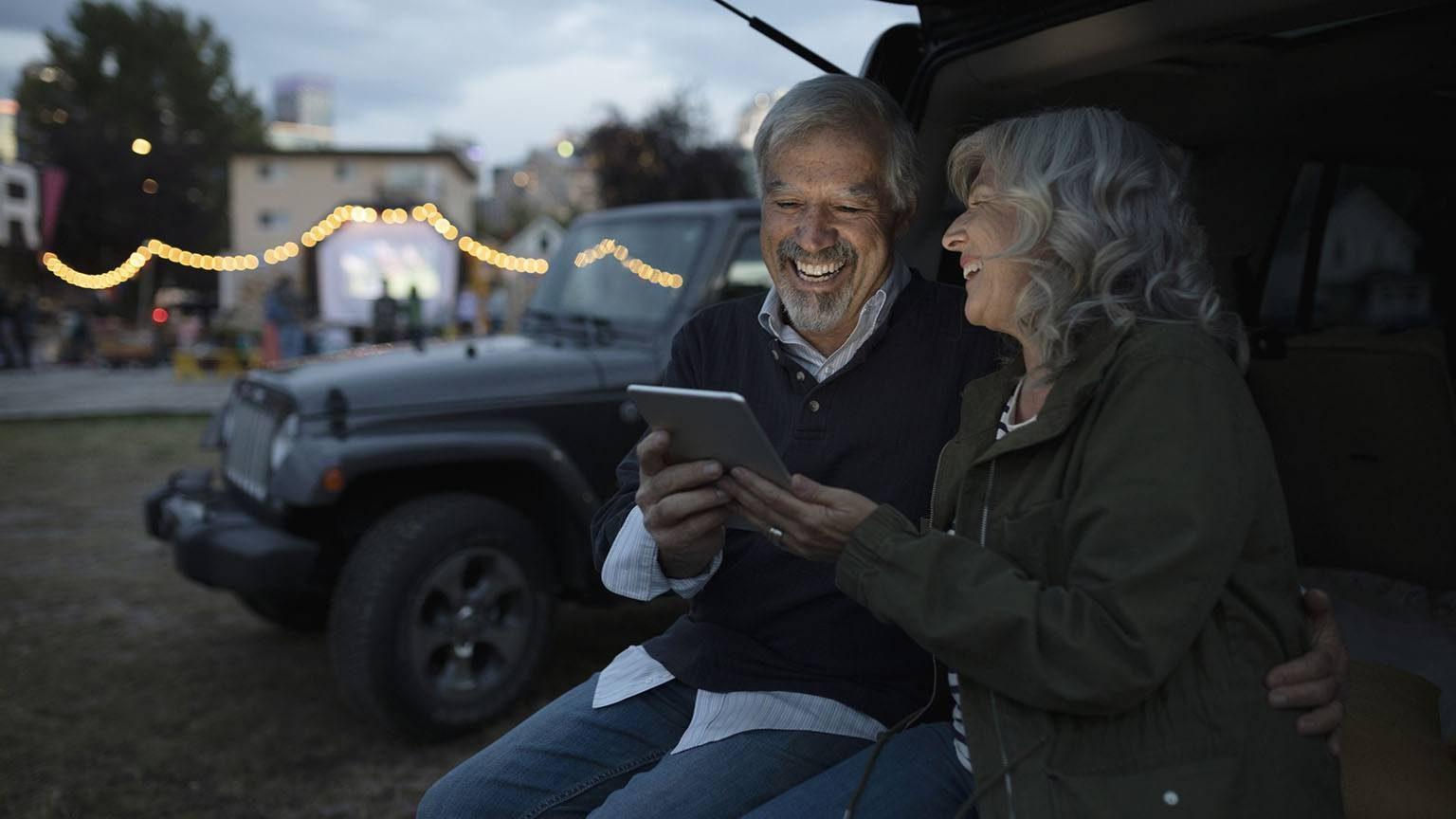 Seniors using digital tablet