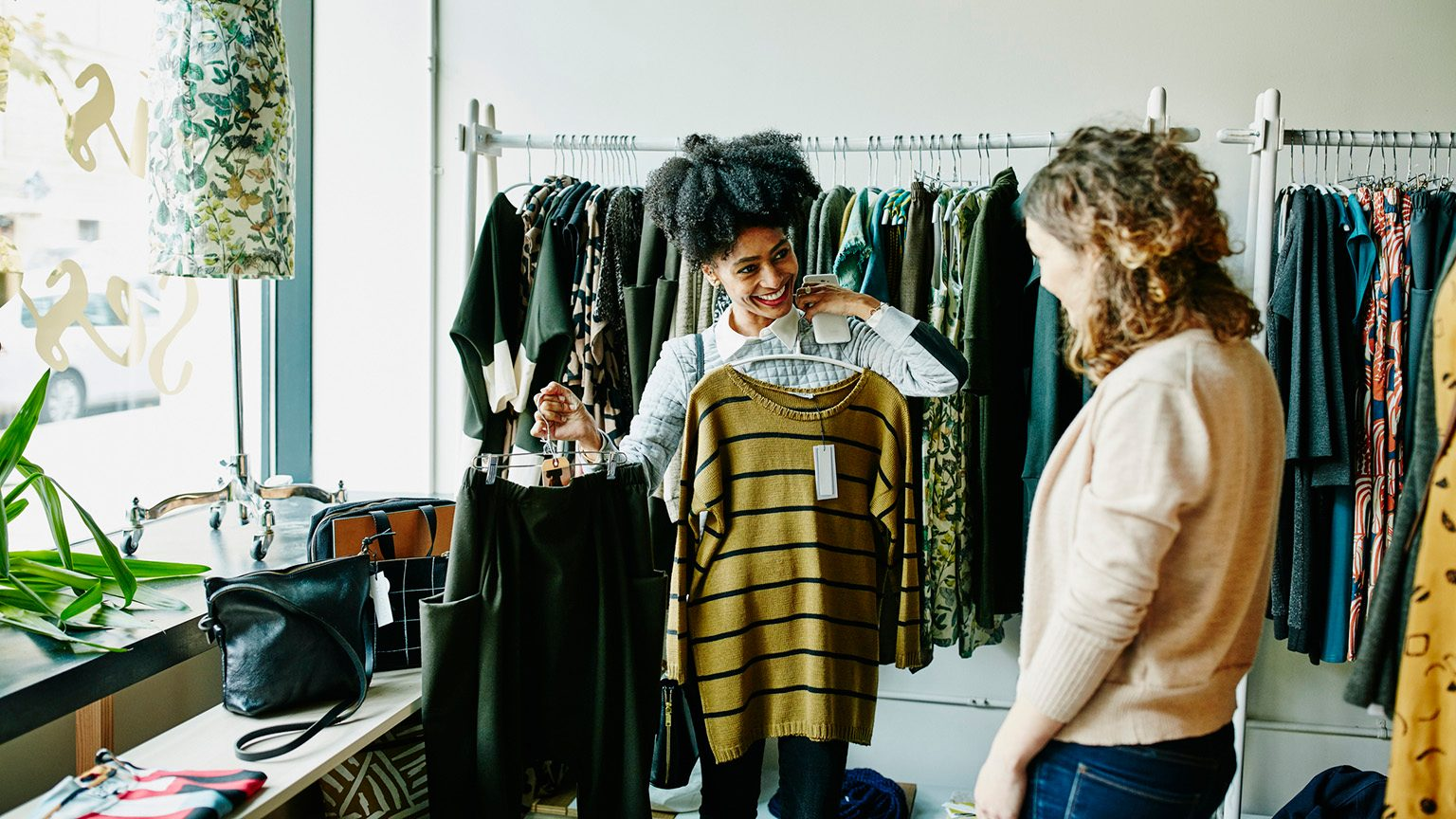 Smiling woman showing clothing options