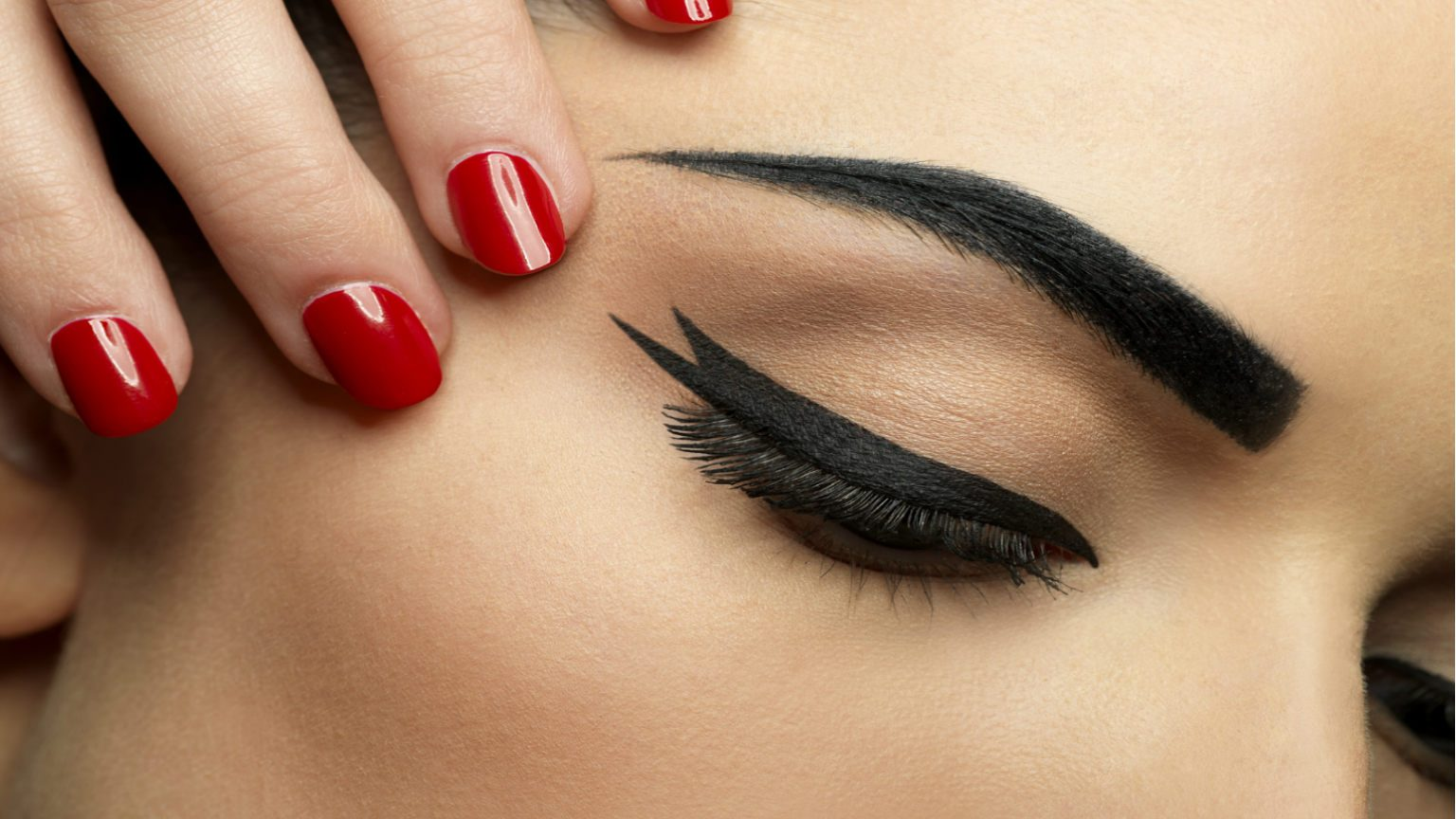 Woman in sharp eyeliner