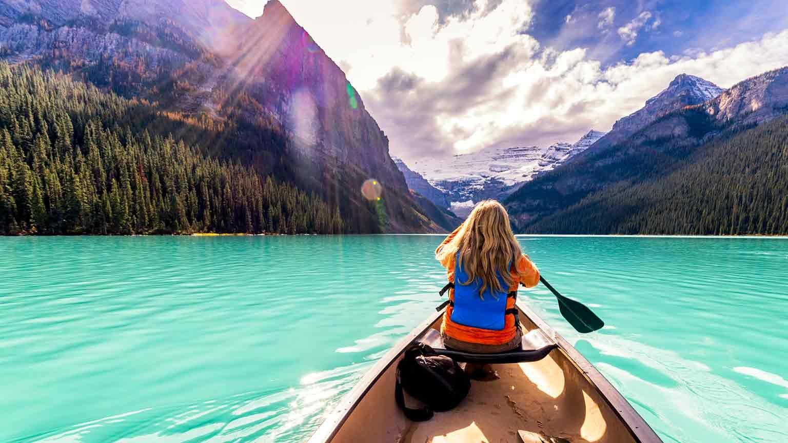 Girl in a canoe at Lake Louise, Alberta, Canada
