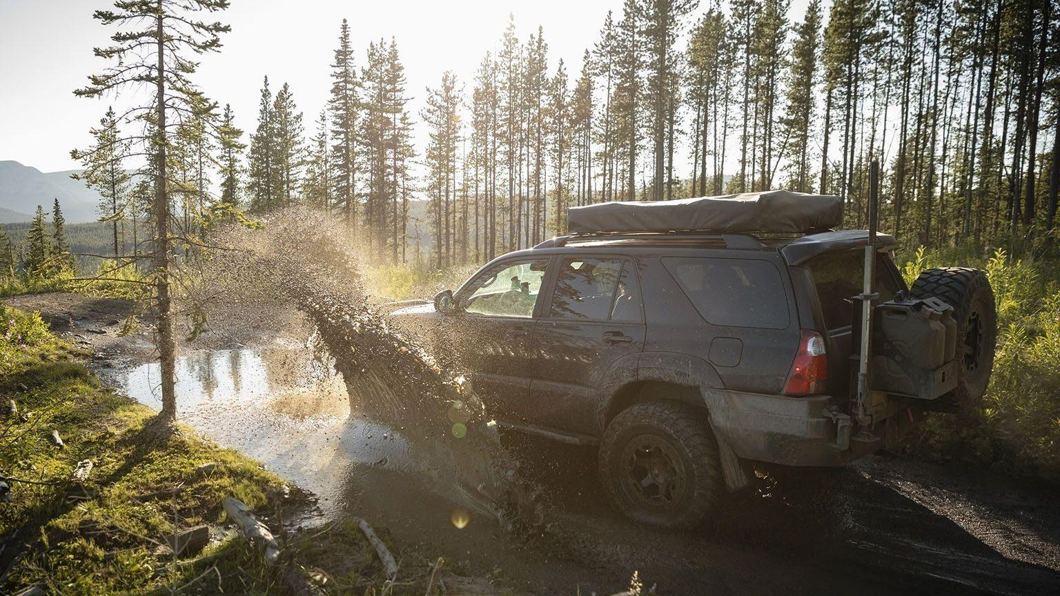 SUV splashing through mud