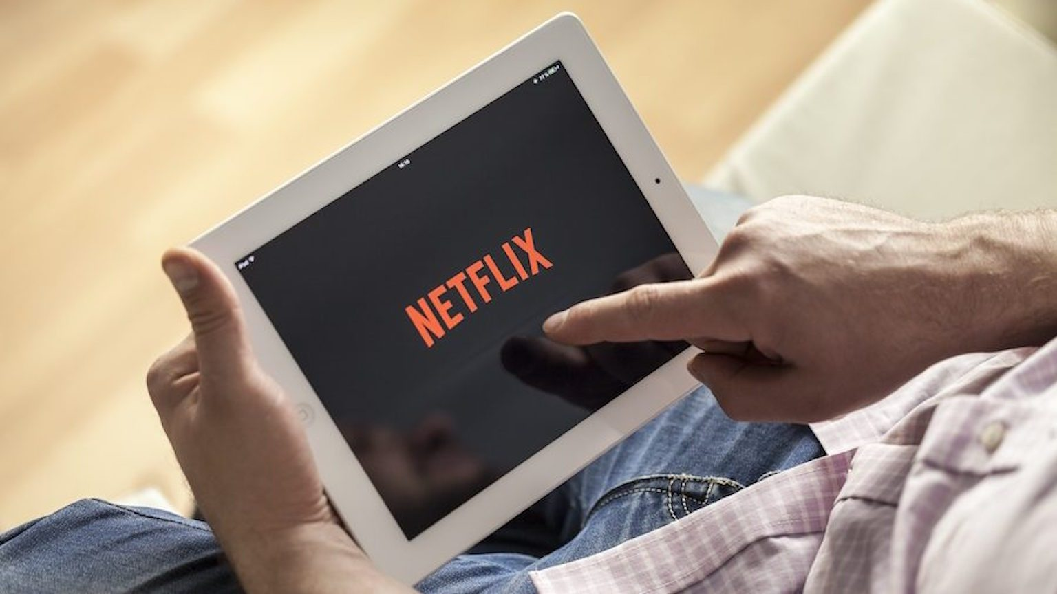 Man watching Netflix on tablet