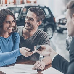 Young lady successfully negotiating vehicle trade-in