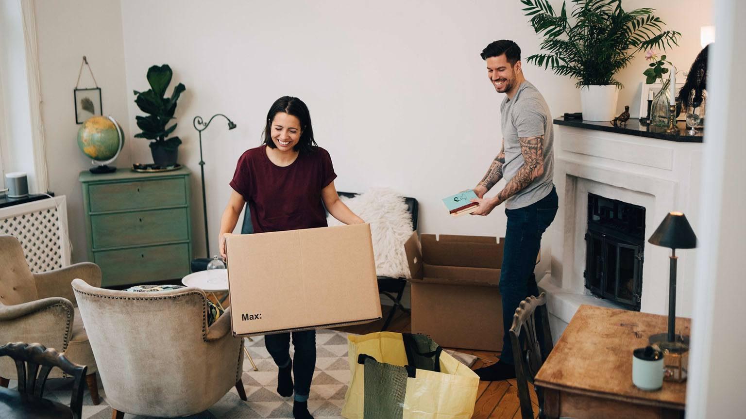Couple unpacking boxes