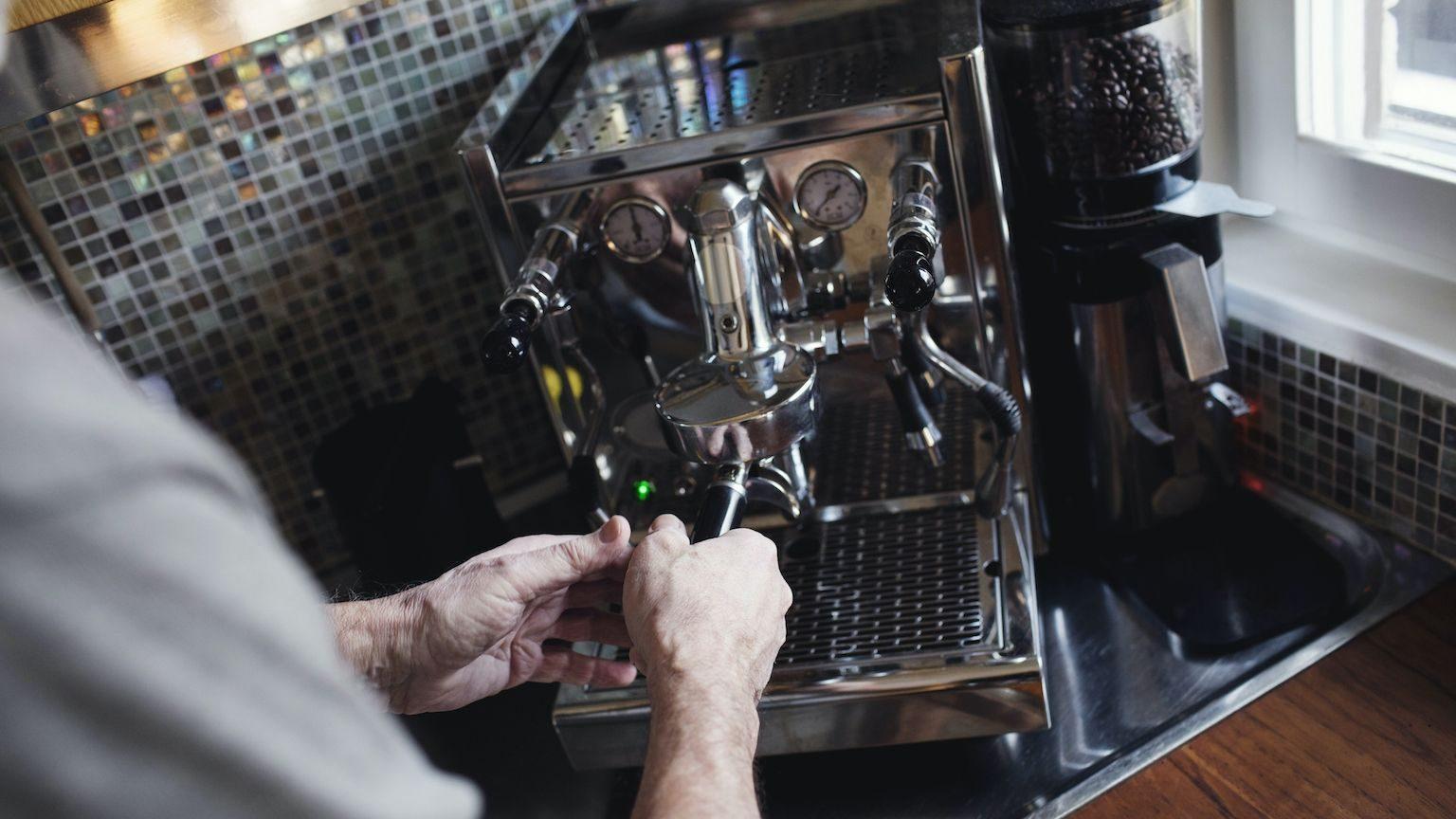 Man making coffee with an espresso machine