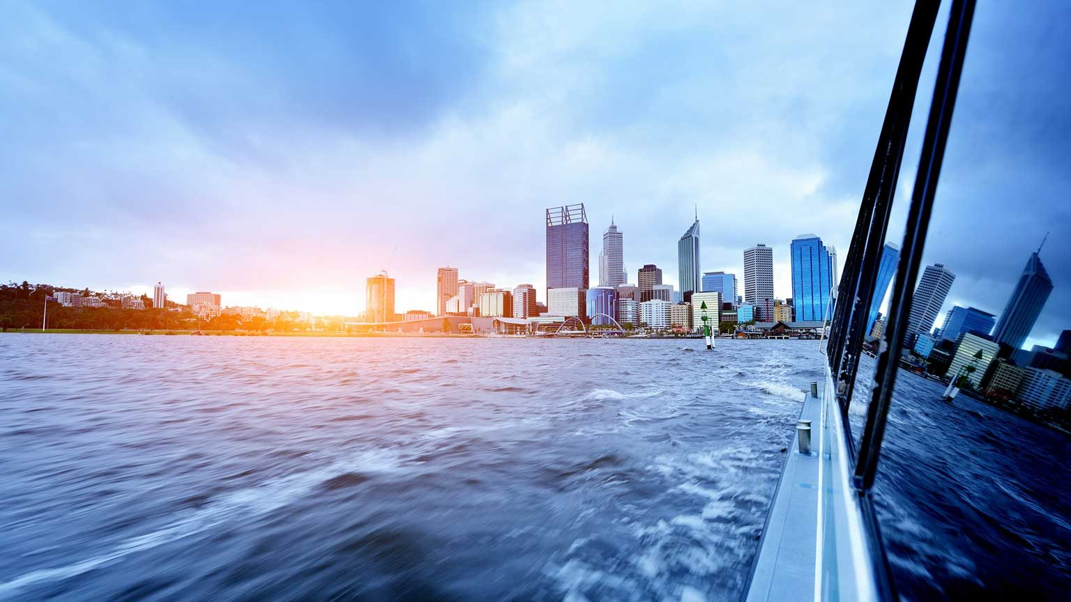 Sunset over Perth CBD from the view of a boat.