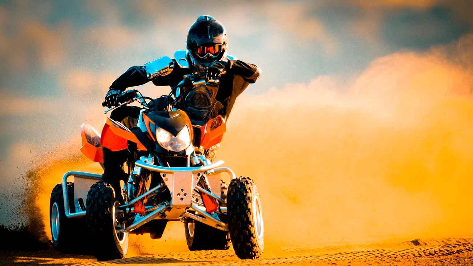 Quad biking in a desert