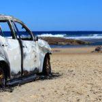 Car burnt on beach