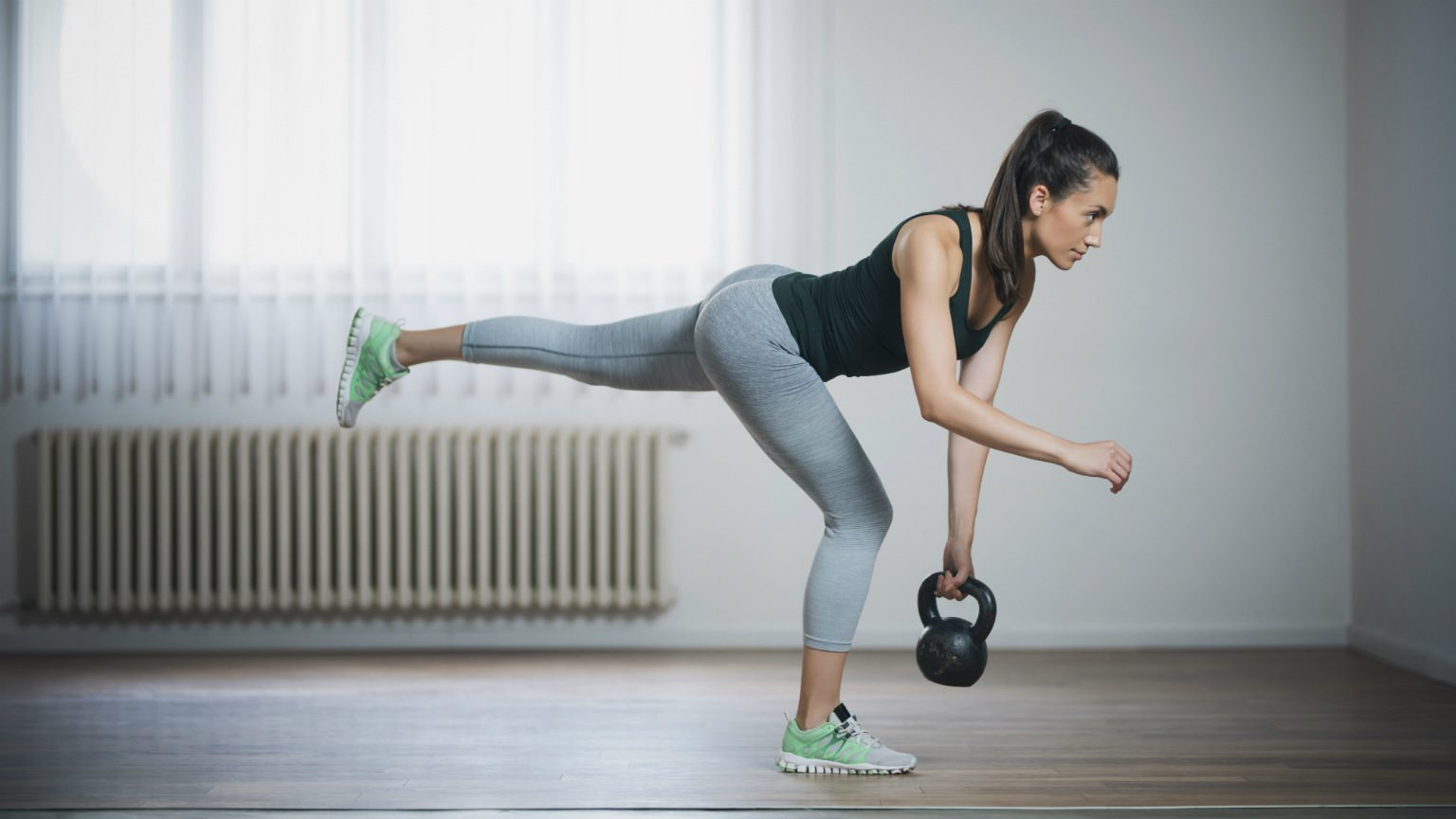 Woman With Kettle Bell