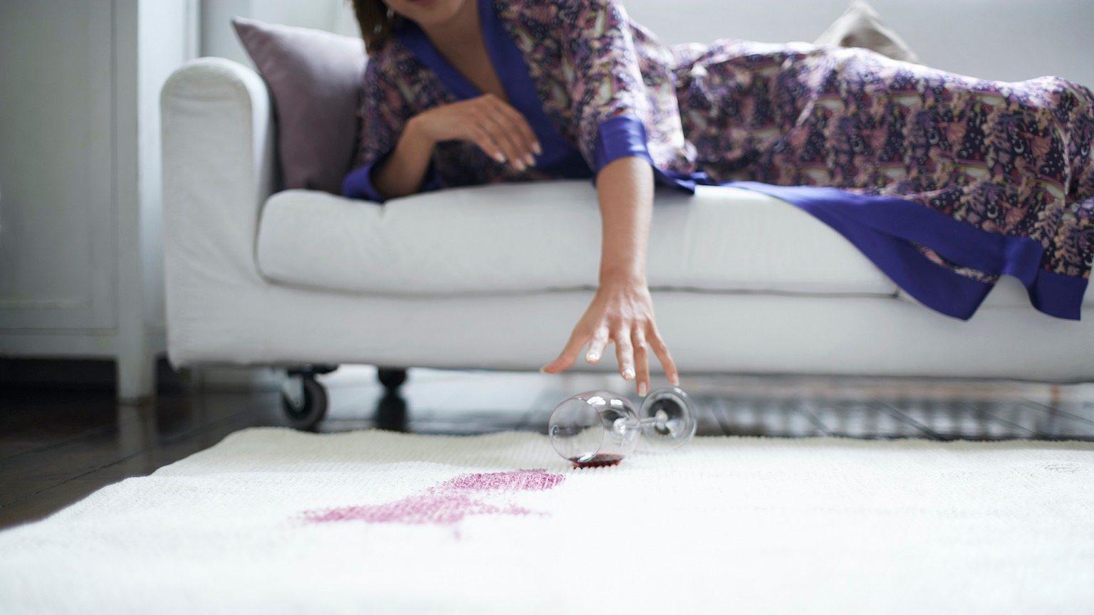 Woman Reaching for Fallen Wine Glass