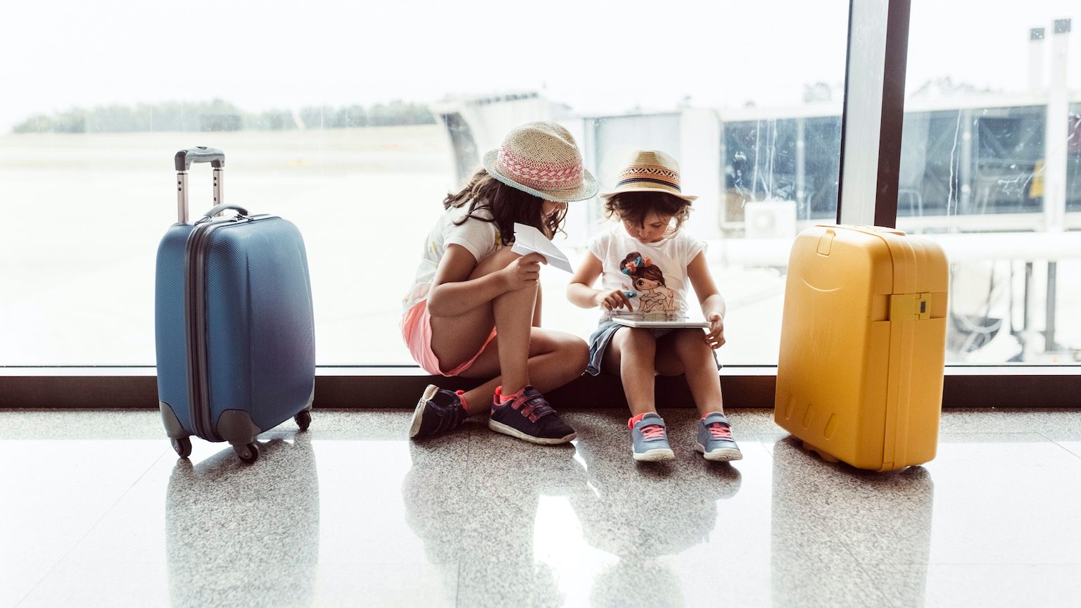 Asturias, Spain, two little girls waiting at the airport terminal