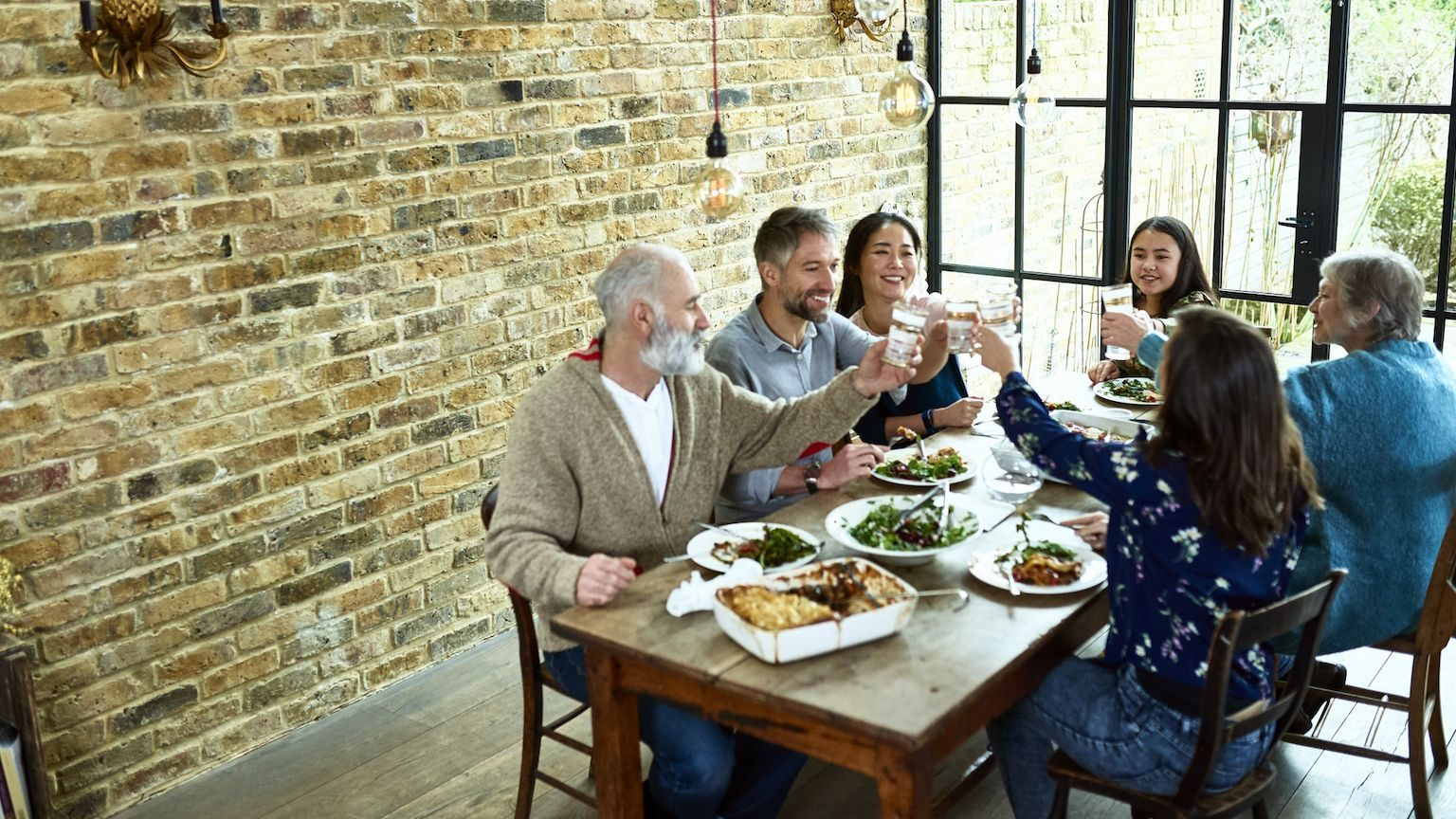 A family eating a meal together at a dining table.