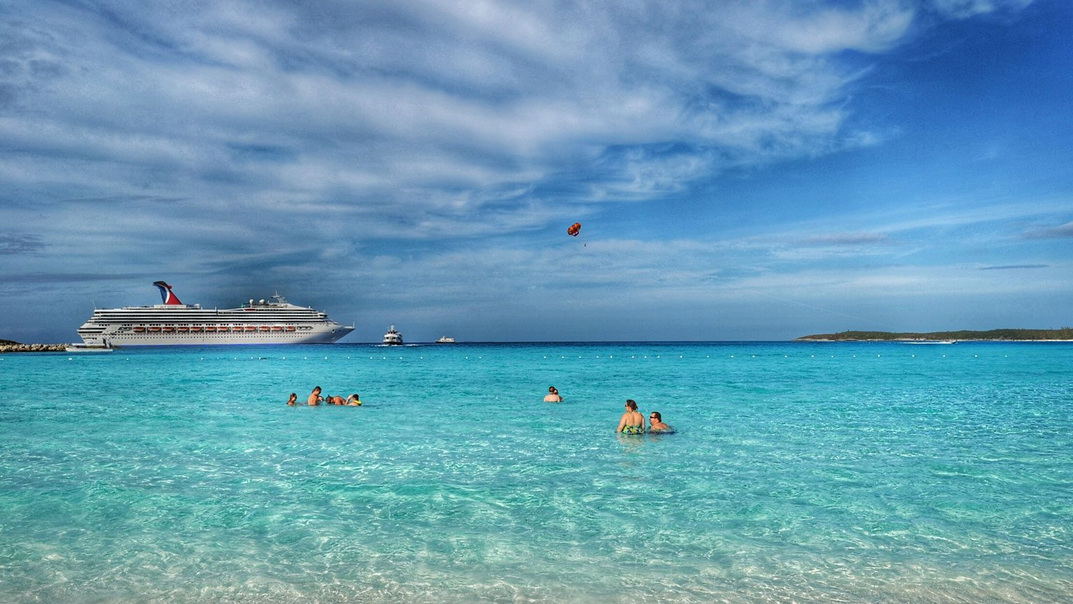 People In Sea By Cruise Ship