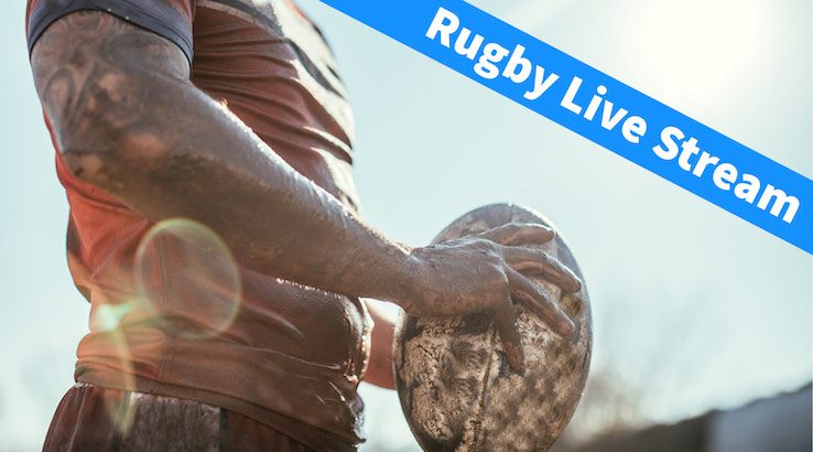 Rugby Player holding muddy ball