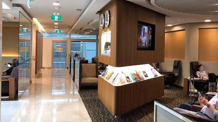 Singapore Airlines SilverKris Business Class Lounge seating and magazine area