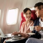 BusinessTravellersOnPlane_GettyImages_450x250