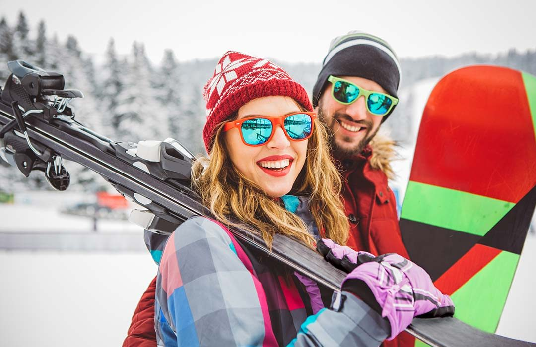 Man and woman skiing and snowboarding