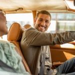 Smiling_Driver_GettyImages_450x250-min