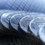 Bitcoins on blue binary code background