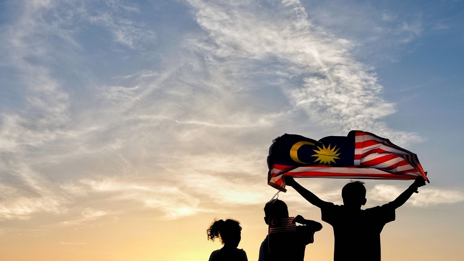 Children waving Malaysian flag