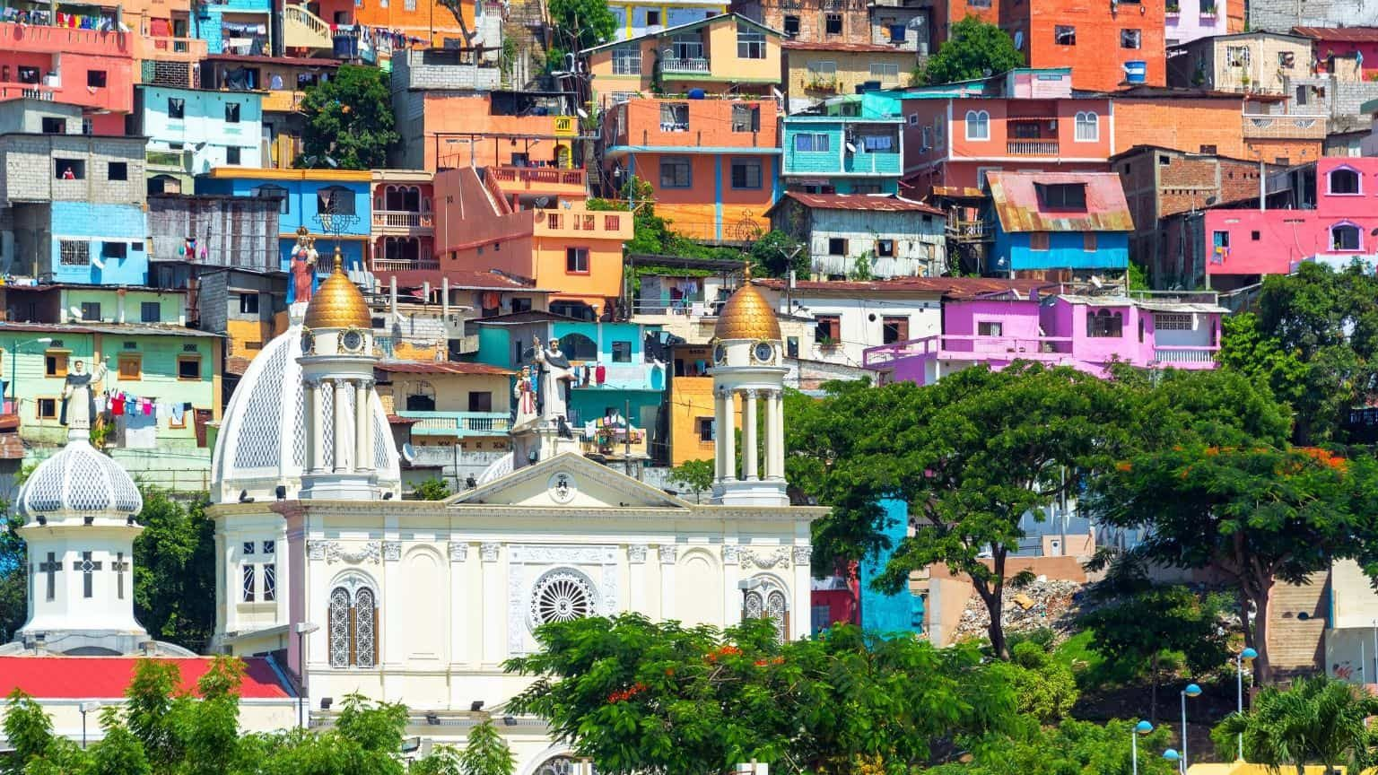 White church with colorful houses in Ecuador