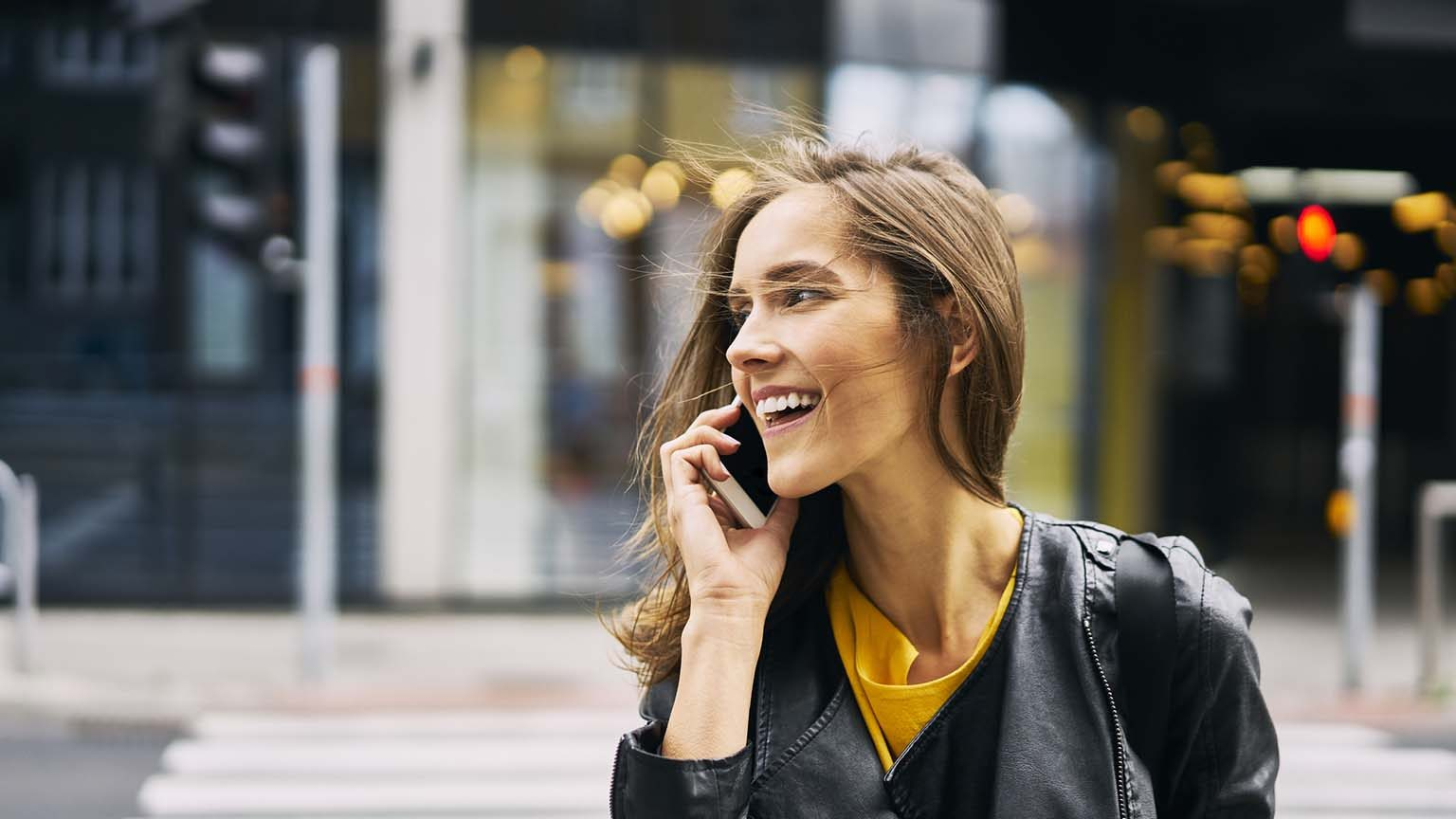 Woman happy on phone