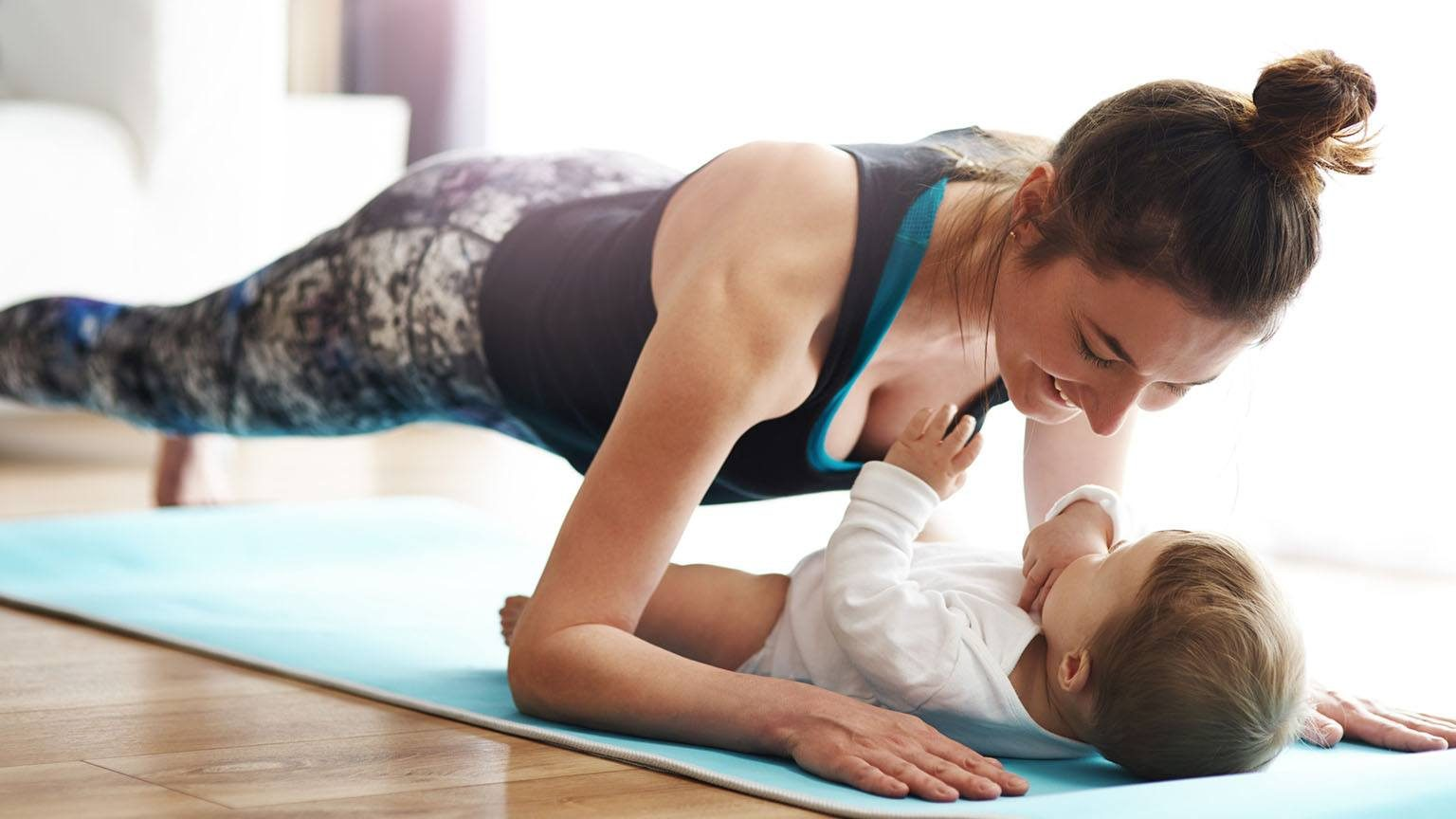 Mother with baby exercising
