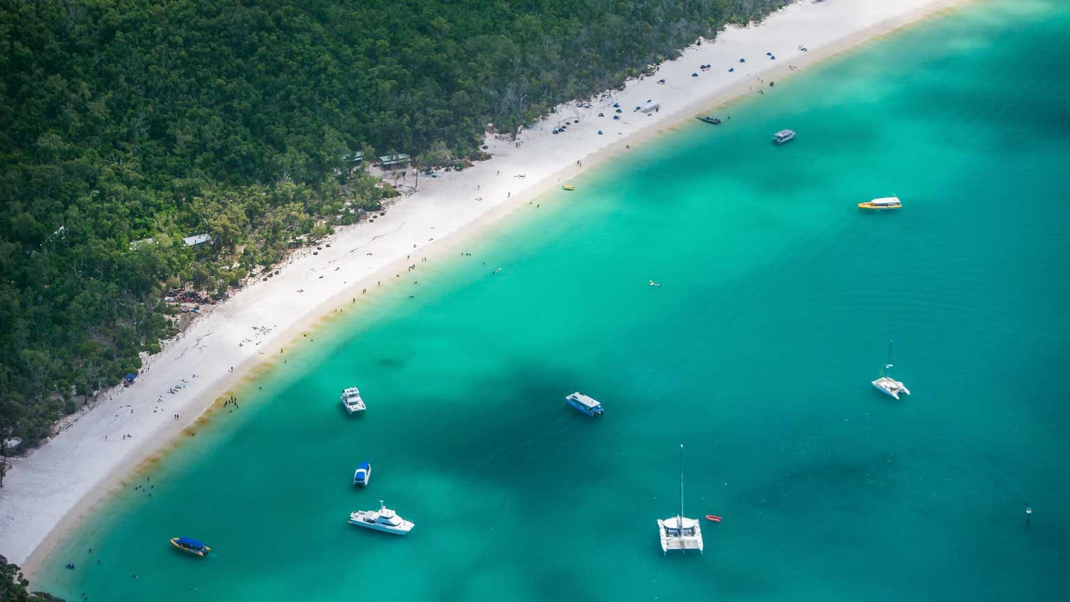 Aerial views over the Whitsunday Island chain and Whitehaven beach.