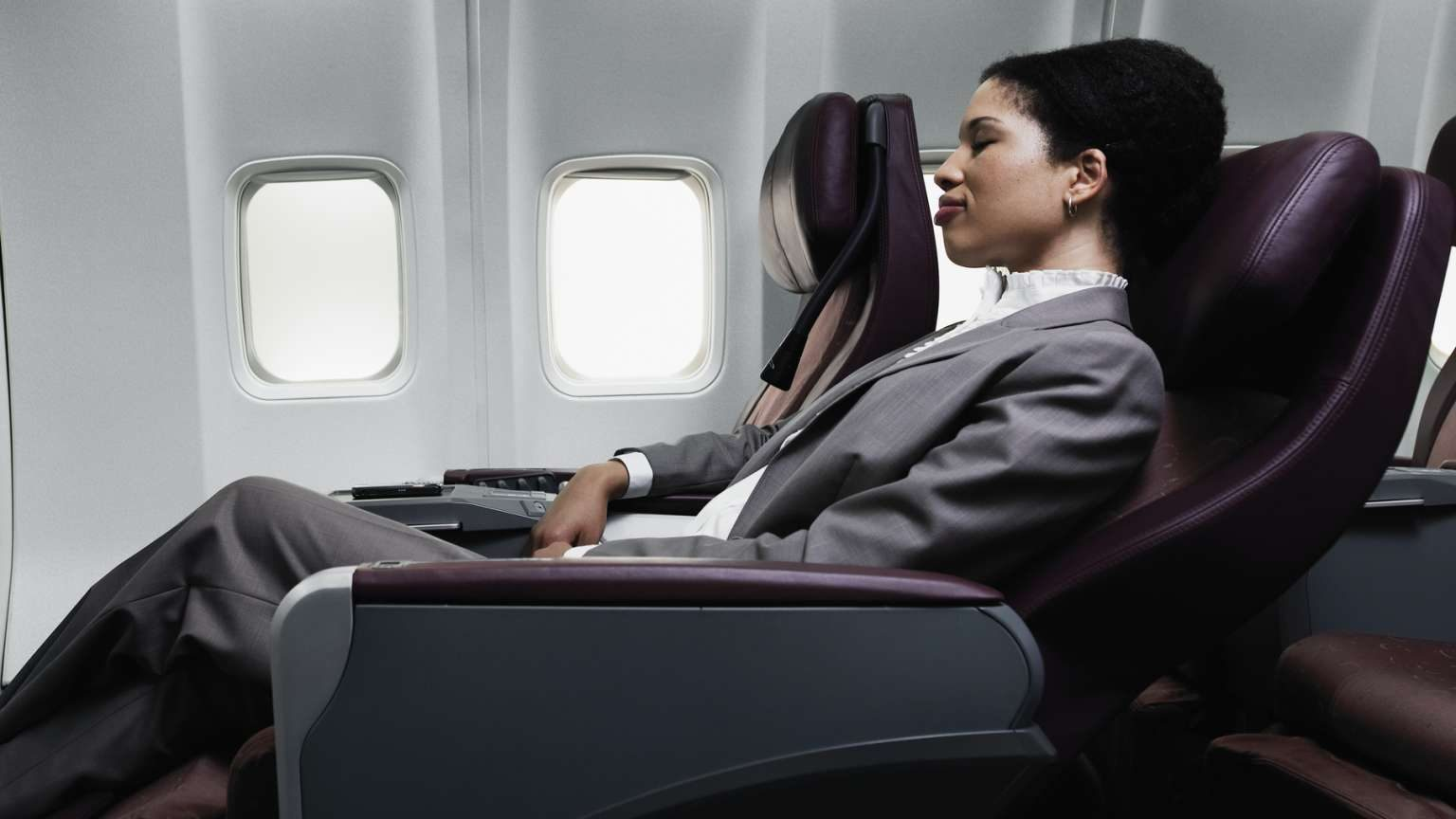 Woman flying business class