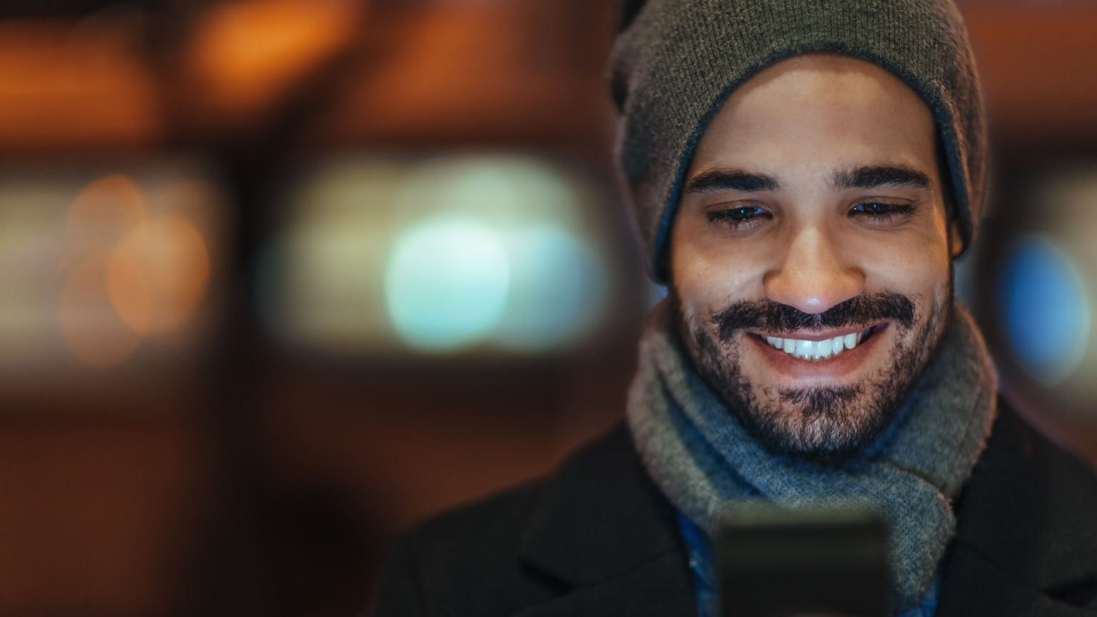 Man with phone smiling
