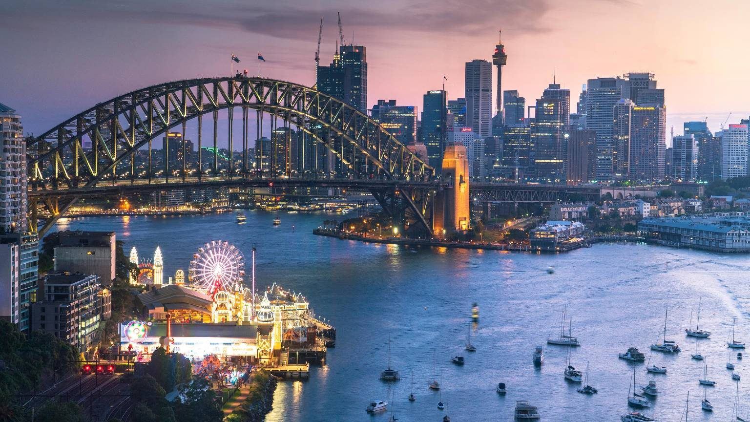 Day to night Luna park and Harbour bridge in sunset from North sydney, Sydney, Australia