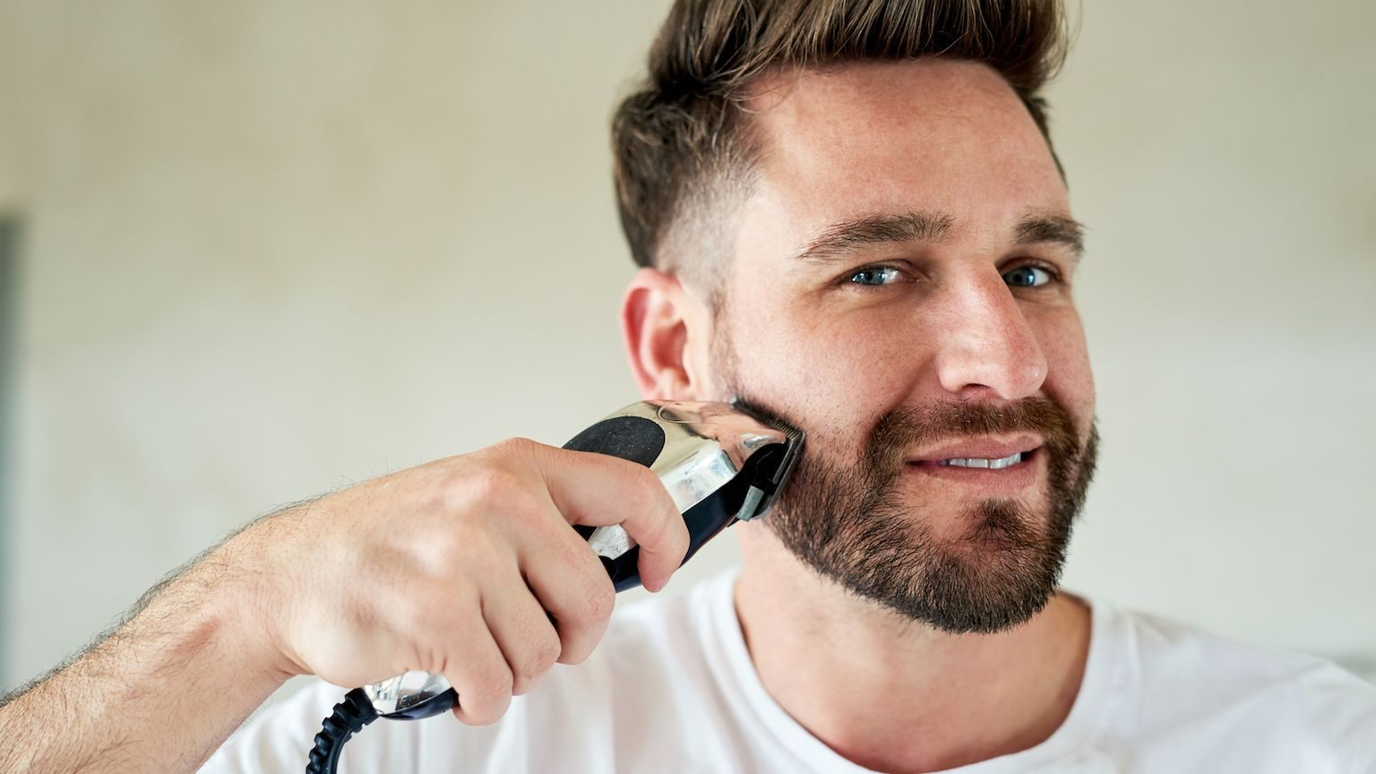 Man using a beard trimmer