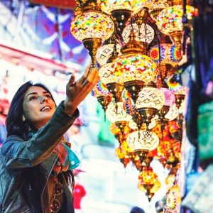 Beautiful young woman shopping in Grand Bazaar, Istanbul, Turkey