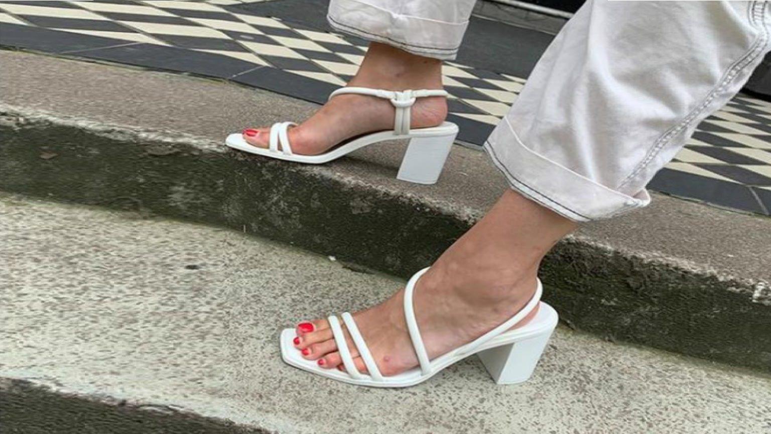 Summer sandals on woman's feet