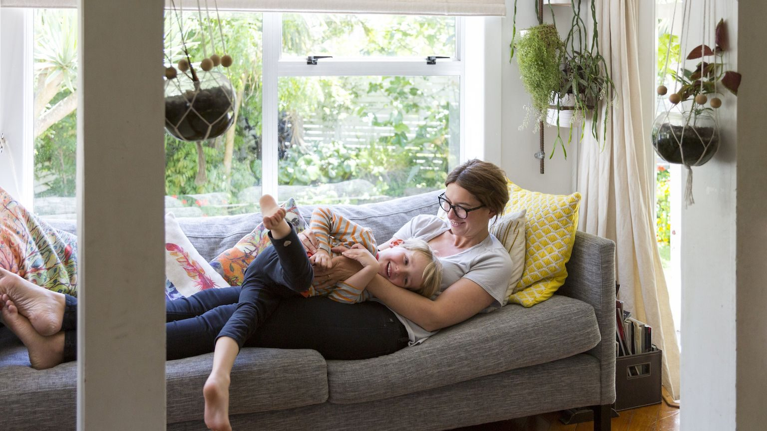 Woman and her son relaxing on the couch together