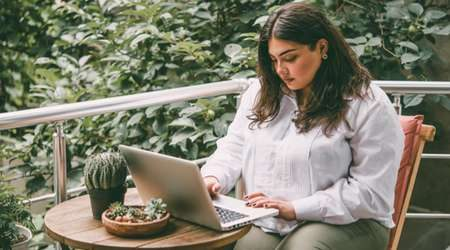 girl-with-plants-on-laptop-450